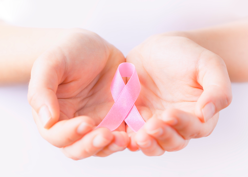 healthcare concept-woman`s hands holding pink breast cancer awareness ribbon