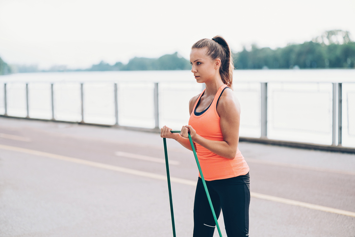 Athlete training with a resistance band